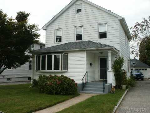 Lovely Updated 2 Family Home With Large Yard And Detached Garage. Upstairs Apt Has New Eik And Cac.