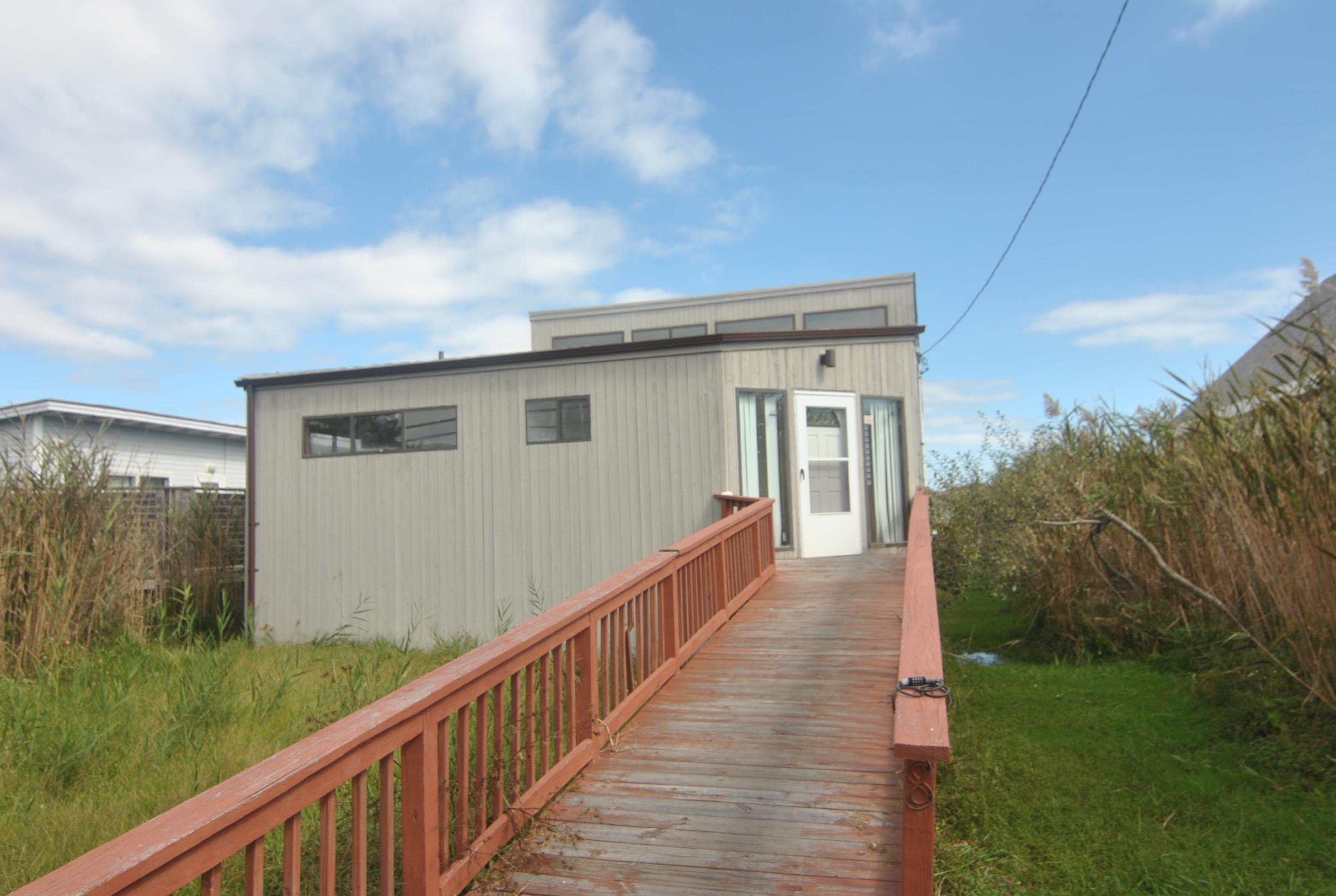 3 Bedroom 2 bath home with open living, dining, and kitchen with high ceilings. Outdoor Shower.