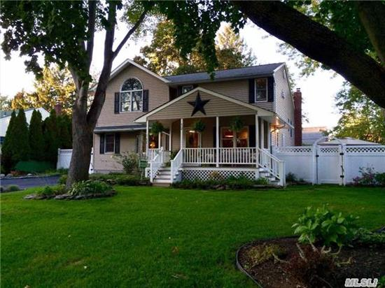 Stunning 2, 200 Square Foot Split With New Granite Kitchen, Updated Baths, Gas For Cooking, Whole House Could Be Converted To Gas. Hardwood Floors, Stainless Steel Appliances, Inviting Front Porch On A Quiet Horse Shoe Shaped Street. All Co's In Place. This Wont Last! Great Yard!