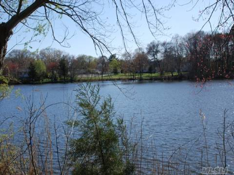 Beautiful Building Lot On Merritts Pond! Tranquility Abounds! Watch The Four Seasons Of Nature At Your Door.