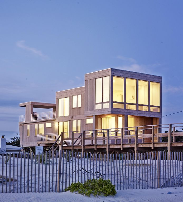 This 4 bedroom,2.5 bath modern beach home has floor to ceiling windows overlooking the ocean. Views to both the bay and the ocean from every room in the home. Outdoor deck with dining area where you can watch the sunsets on the bay or the waves on the ocean. High ceilings, appointed with beautiful new high end furnishings.  Hardwood floors, mahogany deck, stainless appliances, stone counter tops, outdoor shower and all the amenities of home. Impeccably kept with central air and heat, ceiling fans in every bedroom room. Private deck off the master. Steps to the beach.