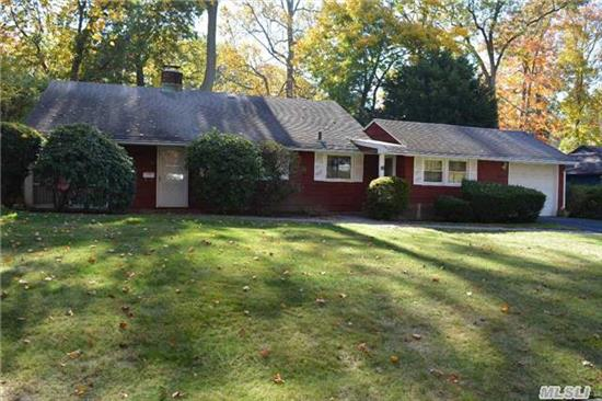 A 3 Bedroom Ranch With 1.5 Baths, Living Room With Fireplace, Kitchen, Dining Area, Den, 1 Car Garage, Tree Lined Property.