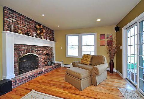 Family Room with Cozy Fireplace and Sliders to Patio
