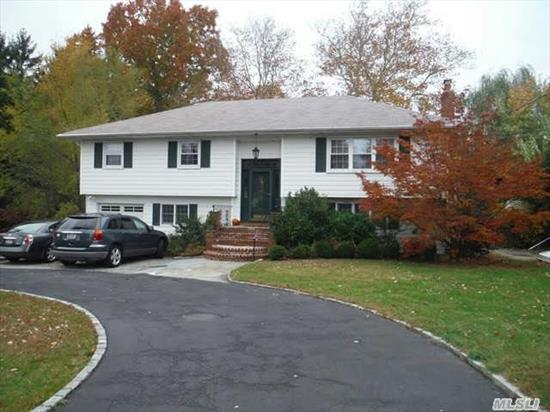 Spacious Bright Hi Ranch On Large Private Lot. Large Kitchen, Master Bedroom W/Bath, Living Rm, Dining Rm W/Large Family Rm W/Fpl. Legal Apartment Is Vacant. Great Potential Income. Beautiful Plantings, Bluestone Patio & Circular Drive.