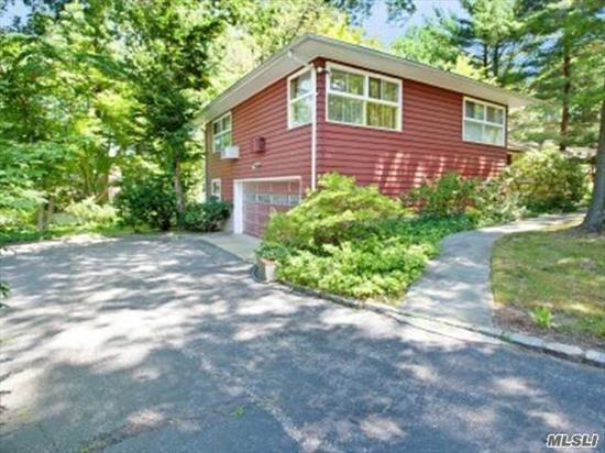 Best Location-Port Washington Train Sticker-Top Roslyn Schools. Spacious 3 Bedroom Home Set On Almost 1/3 Acre In The Heart Of Roslyn Flower Hill. Living Room With Wood Burning Stone Fireplace And Beautiful Hardwood Oak Floors. 2 Car Garage And Plenty Of Storage.