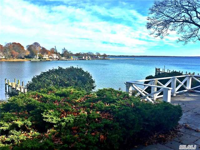 Creek & Bay Views From This 4 Br, 3 Ba Cape W/Dock And New Bulkheading.