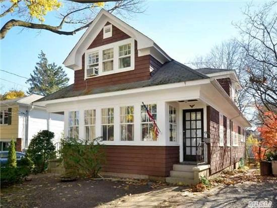 Charming Craftsman Home Nestled On A Quiet Tree-Lined Street. Perfect Starter Home With Legal Rental. Many Original Details Throughout. North Shore Schools, Beach Privileges.