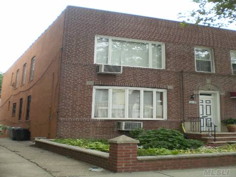 Rare Find  With 3 Parking Spaces, 2 Car Garage, Semi Detached Brick  Legal Two Family With Many Updates.   Masonry Work Done, Newer Windows, Boiler, 2 Hw Heaters. Updated 2nd Flr Apartment Kitchen  With High End Appliances  And Wood Cabinets New Bathroom, 1st Floor Apt Very Well Maintained. All Wood Flrs. Blocks To N,Q Trains To Nyc.  This Home Will Not Last On The Market!