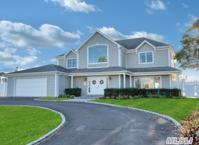 Bay Front Elegant Living In This 4, 250 Sq Ft 5 Bedroom Colonial With High Ceilings And Open Floor Plan. Well Maintained Inside And Out. In Ground Pool And Protected Slip To Dock Your Boat.