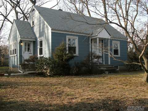 Three Bedroom Cape,Flat Property,Low Taxes On A Lovely Street In East Northport.