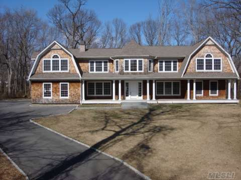This Beautiful Never Lived In Home Boasts A Grand Entry, Amazing Trim Package With Crawford Ceilings And Crown Moldings Everywhere, All Wood Floors, Viking Appliances, Granite Counters, Huge Great Room With Soring Ceiling, Larger Than Average Master Suite, Two Laundry Rooms,  Mahogany Decks, All Cedar Siding, Three Car, Beach And Mooring Rights.