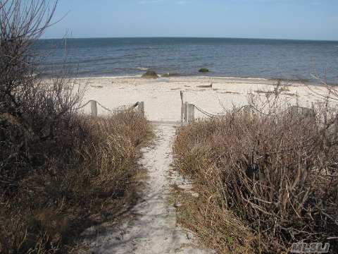 Lovely 2 Bedroom, 1 Bath Cottage Located Directly On Li Sound.  Enjoy The Beautiful Sandy Beach With Sweeping Views That Are Gorgeous Year Round. Property Is Located Directly On The Beach. There Is A Row For Four Other Homes To Use 35' Of Beach From The High Water Mark.