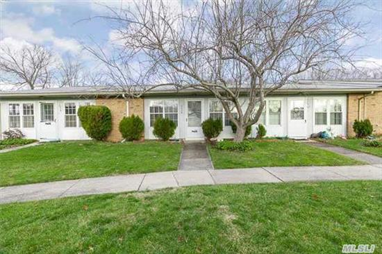 Desireable Greenbriar Model In Gated Community. Lovely Lr/Dr, 2 Bdrms, Efficiency Kitchen, Full Bath, Enclosed Heated Front Porch W/Storage. Back Slider For Easy Access To Parking. Wonderful Amenities. Common Charges Incl Exterior Bldg. Maintenance, Snow & Trash Removal, Lawn Care. Move In Ready...A Must See!