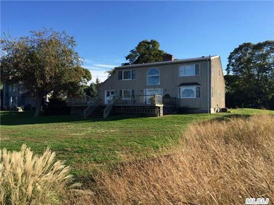 There Are Very Few Of These Kinds Of Properties Available. Location Is Breathtaking With A Views Of Shelter Island. Private Mahogany Dock For Your Boat With 4' At Mlt. Custom Built Home With Great Potential. Some Say It Is All About Location.. If So, This Is It.