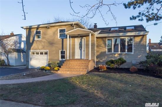 Re-Done & Expanded Split Featuring O.S. Family Rmw/Fpl, Updated Eik W/Granite Counters & S.S. Appliances, Baths, Siding, Windows, Wood Floors, Carpeting, Paint, Sliding Door In Den And Much More. Also Features Vaulted Ceilings, 200Amps, Gas Cooking And W.I. Cedar Closet.