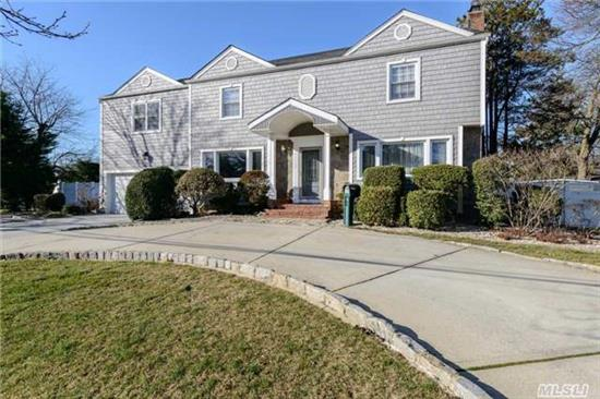 Very Large Home! Exquisite 5Br 3Ba Colonial In Merrick Near Shopping, Freeways, Train. Renovated, Updated. Woodburning Fp, Encl Porch, Eik, Den, Office. Huge Basement, Lots Of Rooms. Full 2 Car Garage. Corner Lot. Circle Drive, Huge Kitchen.