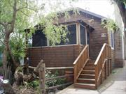 Classic Ocean Beach home with New Kitchen, 3 bedrooms, 2.5 baths, enclosed front porch at tree top