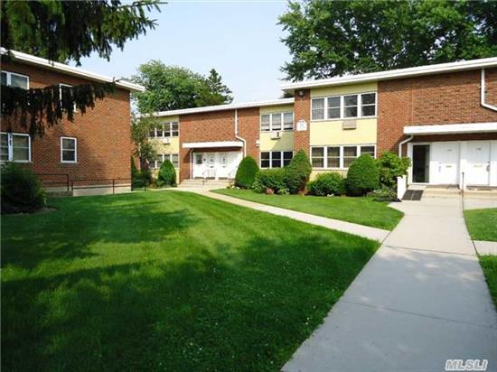 Spacious First Floor Unit Facing Courtyard In Quiet Residential Community. Large Living Room And Dining Room, Eat-In Kitchen With New Washer/Dryer. Updated Electric. Hardwood Floors Throughout. King Sized Bedroom With Full Wall Of Closets, Full Bath. Children's Play Area, Basement Storage Available, Garages Available