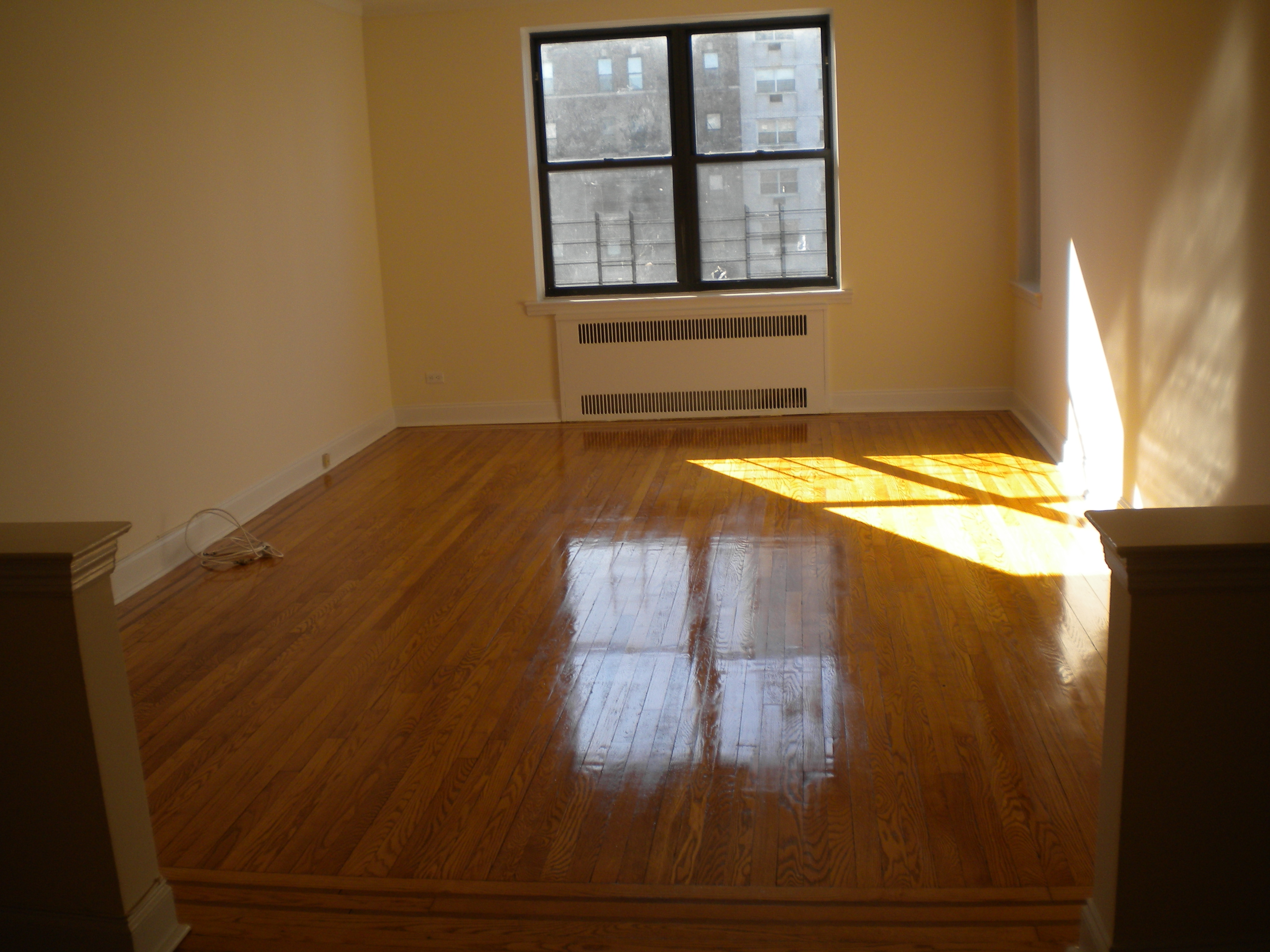 SUNNY!  Extra Large and spacious full 2 bedroom unit.  Apartment features:  Large eat-in-kitchen with all new appliances, large living room and spacious bedroom.   Beautiful hardwood floors, and great closet space. Pet friendly!  Move in condition.  Steps from 71st Continental E & F express trains, and R & M local.  Short walk to Austin St. shops, restaurants, movies, health club, and LIRR.   Contact Debbie to view at 631-691-9771.