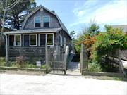 Exclusive Listing: Nice 4 bedroom, 2 bath, Ocean Block, Ocean Beach home!! Location! Large deck with outdoor shower, shed with washer/dryer, front enclosed porch, large living room with Fireplace and open kitchen with breakfast nook. Den and bathroom off kitchen area. 4 bedrooms and bath upstairs. On 50 x 100 ft. lot.