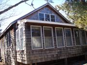3 bedroom, 1 bath, front enclosed porch, living room with loft, wood burning stove, dining room with 2nd wood burning stove, lots of windows and sky lights make this home very light and airy. Large back deck with hot tub and outdoor shower. Ocean Block location in quiet area. Excellent rental history.
