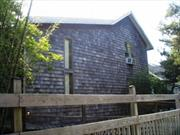 Newly wood re-shingled siding, new large back deck with hot tub and outdoor shower. This 4 bedroom, 2 bath home is a wonderful home for large family gatherings and entertaining. All bedrooms have A/C, large living room with fire place. Huge kitchen, and dining area. All wood floors throughout. Ocean block location with excellent vacation rental history.