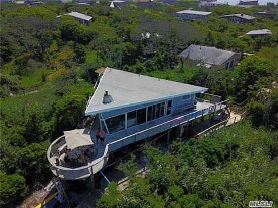 Waterfront!!!!!!!! This Special House Is Right On The Great South Bay With Its Own Sandy Beach. In A Quiet Area East Of The Marina. It Offers Superb Location And Beautiful Sweeping Bay Views And Sunsets.!!! Clever Boat-Like Design { Named The Boat House}Bow Points To The Bay. Large Open Entertainment Area With Lots Of Glass To Get The Most Of The Views. 5 Bedrooms!