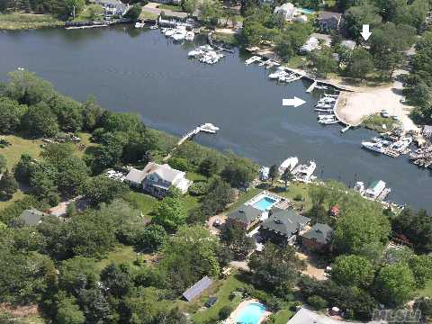 Aquebogue Deep Waterfront Dockage! 2 Parcels, One With 14 Boat Slips, Launching Ramp & Buildable, 2nd With Dock And Cottage With 2 Bedrooms 1 Bath, Living Room, Kitchen, Dining Room Or 3rd Bedroom, Enclosed Porch, Basement & 3 Car Garage.