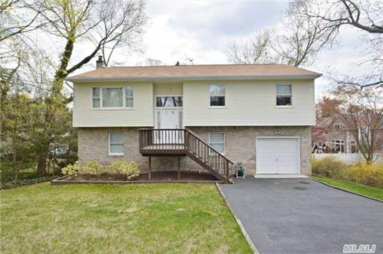 Wow!! Young, Beautiful And Spacious Bi-Level With Full Basement! Custom Home Features Gleaming Hardwood Flooring Throughout, Cathedral Ceilings, Beautiful Tiled Baths, Sparkling Large Eat-In-Kitchen. Large Great Room (13' X 24') Great Space For Home Office. This Home Is Light, Airy And Meticulous!!!