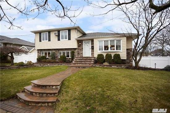 Immaculate Exp Split, Oversized Lot, Brand New Front Stone Work, Hardwood Floors, Eik W/ Granite & Stainless, Peninsula,  Brkfst Room & Bonus Den/Office W/Vaulted Ceilings , 2 Split Unit Cac's, Radiant Heat In Newly Renovated Bath & Fam Room, Partial Base W/ Laund & Util, Fam Rm W/Sliders To Yard, Paver Patio, Ig Heated Salt Water Pool, Retractable Awning, Prof Landscaped.