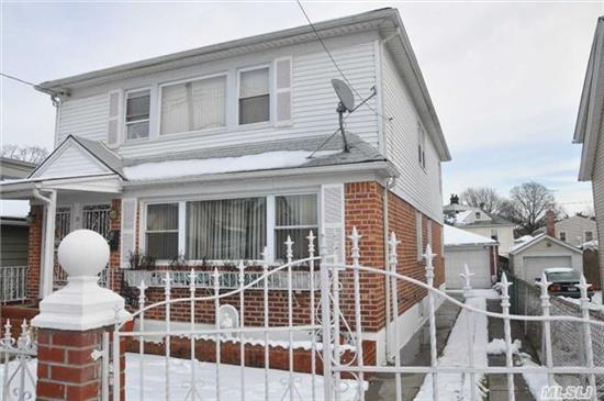 This Spacious Two Family Colonial Sits On A Very Quiet Block. Two Car Garage, Nice Yard And Patio, Finished Basement With Separate Entrances. Gas Furnace. Newer Roof. Five Bedrooms, Three Bathrooms. Ideal For Large Family. Nearby Public Transportation.