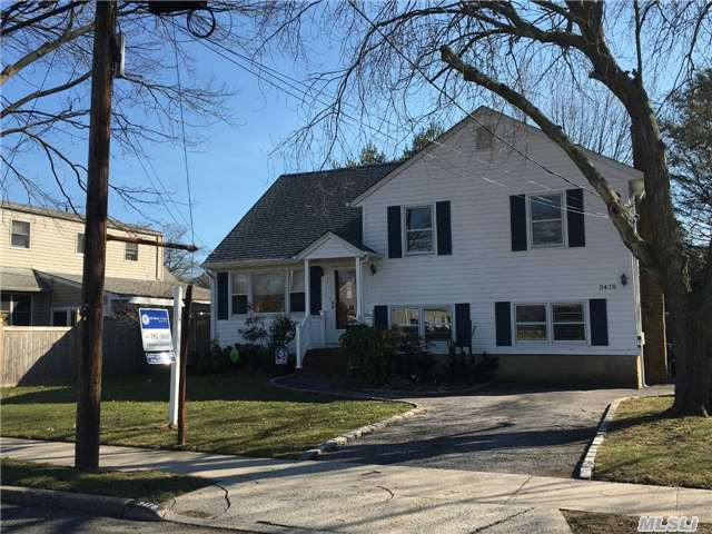 Large Split In Beautiful Wantagh Woods. Extended Kitchen With Side Family Room And Sliders To Deck, Formal Living Rm And Dining Rm With Hardwood Floors Throughout. 3 Bedrooms And Bath On 1 Level With Mst Suite And Full Bath On 4th Level. New Roof. Outside Deck And Patio. Den With Brick Fireplace, Laundry Room And Plenty Of Room For Entertaining. Move In Condition.