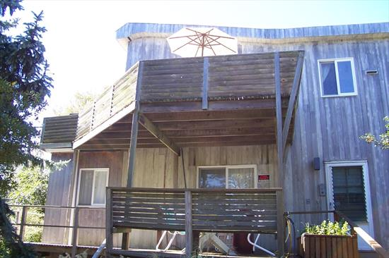 Large 2 story home on 80'x80' lot. Room for auto and cart parking with 1 car attached garage. Completely enclosed area under the house for storage, etc. Lots of room outside for gardens or storage. Rear of the building has a 7x25 ft attached shed with a workbench. There is also an enclosed outside shower. This was a builders residence, set up for occupancy upstairs into the winter. Was rented for $3500/week this past season. Downstairs features a large open area, 2 bedrooms, full bathroom, wash/storage room, and a large unfinished attic for storage and entry down to garage. Upstairs has another large open area with vaulted ceilings, galley kitchen, master bedroom with a king bed, walk in closet, and full bath. Decks are wrapped around 3 sides on both floors. No Sandy damage whatsoever.  Perfect home for a contractor or someone desiring something larger than the 3br 900 sq ft ranch common to the area. Most furnishings are included.