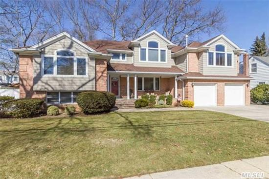 Beautifully Expanded Up & Out In 2003. This Split Features A Unique Layout Including Large Eik W/Granite Counter Tops & S/S Applcs, Oversized Fdr, Great Rm W/Wet Bar & Gas Fplc, Mstr Br Ste W/Mstr Bth & Wic. All Lg Bdrms,  Gleaming H/W Flrs, Crown Moldings, 5 Zone Ht Incl: H/W, Radiant & H/A. 2 Zone Cac. Wired For Sound, Plenty Of Storage, Lovely Entertainment Yard.