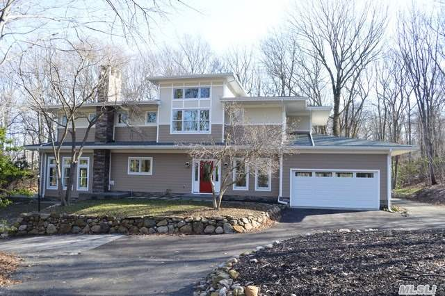 Stunning Colonial Features An Open Floor Plan W/4 Bdrms/4 Full Bths/Granite Eik W/Center Island &Stainless Steel Appls/Formal Dr/Sunken Lr W/Fireplace And Wall-To-Wall Windows With Winter Water Views Of Port Jeff Harbor/ Master Suite W/En Suite/Private Terrace And Walk-In Closets/ Central Air / Solid Wood Doors/Hardwood Floors Thru-Out/ Full Finished Basement