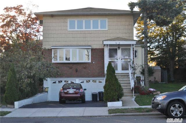 Beautiful 2 Family House In Bayside For Sale. 1st & 2nd Floors Feature 3 Bedrooms, 2 Full Baths, Living Room, Formal Dining Room And Eat In Kitchen. Deck On First Floor. Full Finished Basement W/ Family Rm, Laundry Rm, Boiler & Work Rm. 2 Car Garage & Driveway. In District 26. Great Opportunity!