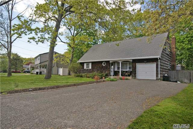 Amazing Opportunity South Of Montauk Hwy. This Home Offers Eat-In-Kitchen, Family Room, First Floor En-Suite, Guest Bedroom, Partially Finished Basement And One Car Garage. The Second Floor Affords Two Large Guest Bedrooms & Full Bath. Enjoy Summer Evenings In The Backyard With Deck For Dining & Private Beaches Rights. Potential For Legal Mother Daughter Don't Miss.