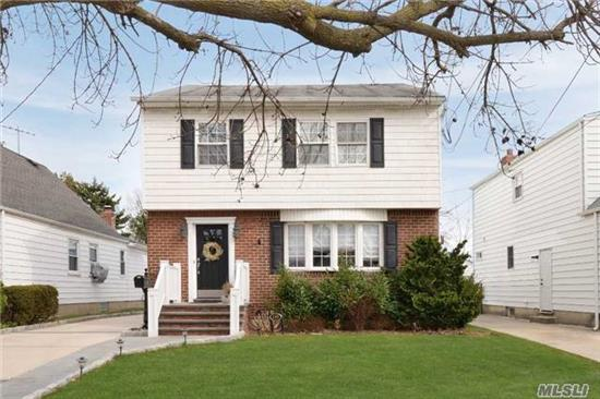 Beautifully Renovated Colonial. 4 Bedrooms, 2 Full New Baths, New Hardwood Floors, Gas Fireplace, New Kitchen With Stainless Steel Appliances, Quartz Countertops, Huge Family Room. New Patio & Driveway, New Fully Finished Basement With Ac, Oversized Lot. Perfect Mid Block Location!!
