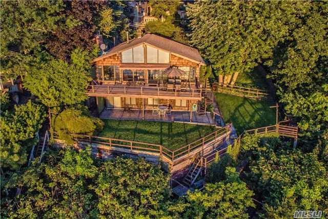 Once In A Lifetime Opportunity To Own A Magical Spot On Bay Ave!  Mid Century Modern Flair With Soaring Ceilings,  Huge Decks Overlooking Hempstead Harbor,  Private Stairway To The Beach,  2 Car Garage,  North Shore Schools.