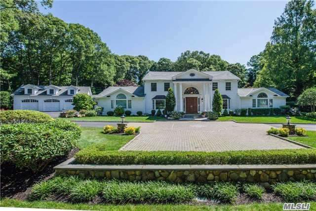 Gold Coast Meets Dix Hills In Elegant Estate Home.Beautifully Renovated- Features Huge Dream Kitchen W Eating Area Looking Out To 2 Private, Manicured Acres W Gunite Pool & Koi Ponds.Home Boasts Grand Entry Foyer, Architectural Details, 3 Fireplaces, 5Br's, 7Bths, 3 Lr's, Billiard Rm, Movie Theater, Guest Ste On Main, Wine Cellar.Better Than New!Taxes Being Grieved.