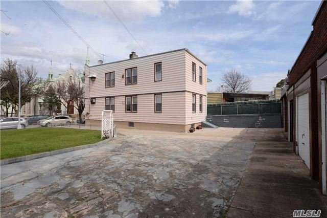 Vacant Land In Maspeth On 40X100 Lot, With Next Door 2 Family House On 23X100 Lot,  Total 63X100. 6 Garages In The Back. Zoning R4-1. Ideal For Multifamily Development Site.