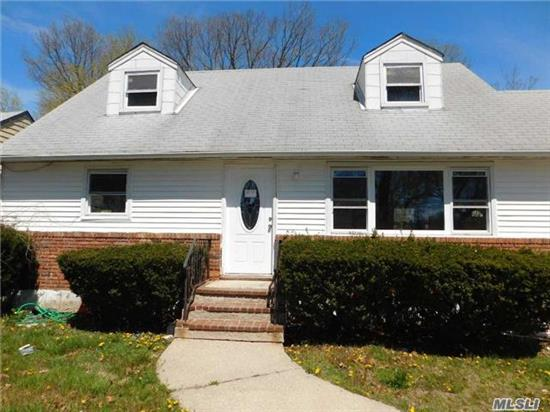 Great Opportunity For First Time Home Buyer. Move In Ready. 4 Bedroom Cape In The Desirable Harbor Fields School District.