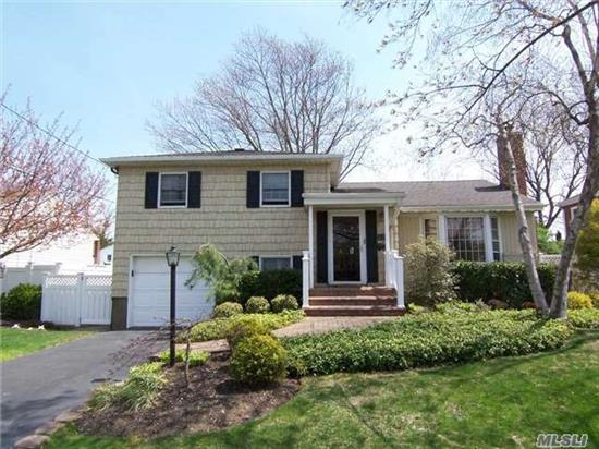 Expanded Split Level In Mass Park, On Quiet Mid-Block Location.Features Living Rm With Cathedral Ceiling/Fireplace, Eik W/Updated Stainless Steel Appl, Formal Dr, Extended Family Rm, Bonus Rm/Play Rm, Master Suite W/Walk In Closet And New Bath, Hardwood Floors, Professionally Landscaped/Brick Patio, Igs And More!