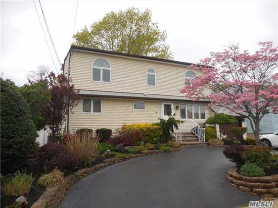Attention Property Lovers!! Lovely Large 4 Bdrm 3Bth Colonial With 2 Mstr Bdrms W/Full Bths (One On Main Level), Lrg Bright Den W/Pella Glass Doors Leading To A Lrg Deck Overlooking Oversized Park-Like Backyard, Hw Flrs, Cac, Igs, Circular Driveway, New Roof, Alarm. Camp Ave Elementary, Merrick Ave. Middle School, Cahoun High School. Taxes Are Without Star!