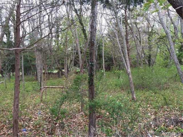 Partially Cleared Property In Southold Laughing Waters Community With Association Marina . Perfectly Located A Short Distance Between Two Sandy Peconic Bay Beaches And Walking Distance To Wineries Making This The Perfect Place To Build Your North Fork Dream Home.