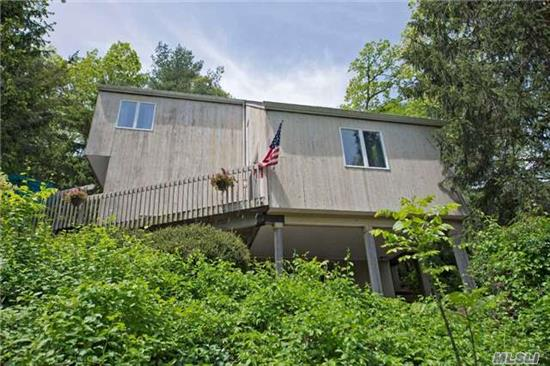Wonderful Contemporary! Winter Waterviews, Three Levels Of Living, 3 Br, 2.5 Baths, Living Room, Dining Room, Updated Kitchen, New Oil Burner, Wood Floors Throughout, Expansive Decking, Updated Baths, New Hw Interior Doors, Privacy & Charm!