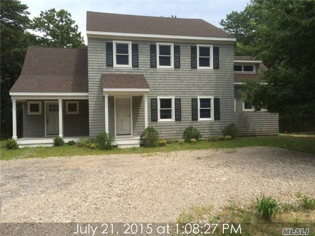 Cedar Sided Colonial With Modern Open Floor Design Located On A Low Traffic Tree Lined Street Close To Sag Harbor Village Amenities Full Basement With 8' Ceilings , This Could Be A Great Blank Canvas To Start From Sold As Is