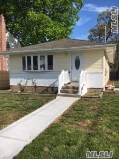 This Fully Renovated Updated Ranch Features 3 Bedrooms, Brand New Kitchen, Brand New Bathroom, New Heating, New Plumbing, New Windows, New Boiler, New Rook, New 4-5 Car Driveway, And A Full Finished Basement W/ Side Entrance To House! Corner Lot! Close To All! A Must See! Wont Last!!