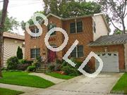 Seller Blow Out! Rare Find! True Center Hall Brick Front Colonial Only 4 Years Young, Mid-Block Tree Lined! 4 Bdrm 2 1/2 Bth, 9 Ft Ceilings, Approx. 30 Ft Granite/Stainless Eik-Lots Of Cabinets,Double Oven,Bay Window And Butler Pantry Leading Out To A Deck And A Beautifully Landscaped Backyard, Den W/Gas Fplc,Marvin Windows, Crown Molding, Hw Thruout, Won't Last!!