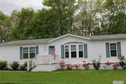 Bright Open Floor Plan Ranch. Huge Kitchen. High Ceilings, Skylight. Beautiful 4 Seasons Room With Private Woodland Views. Large Covered Deck. Handicap Access With Ramp On Side Of Home With Carport. Great 55+ Active Adult Community In Peaceful Rural Setting. Convenient To North Fork, Hamptons, Tanger Mall And Beaches. Live The Simple Life! Welcome Home!